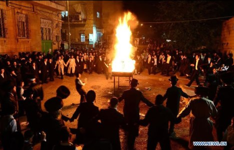 Jerusalem, April 27, 2013: Ultra-Orthodox Jews dance around a bonfire on Lag BaOmer, a Jewish holiday that has been reinterpreted in modern times as commemorating the Bar Kokhba revolt.